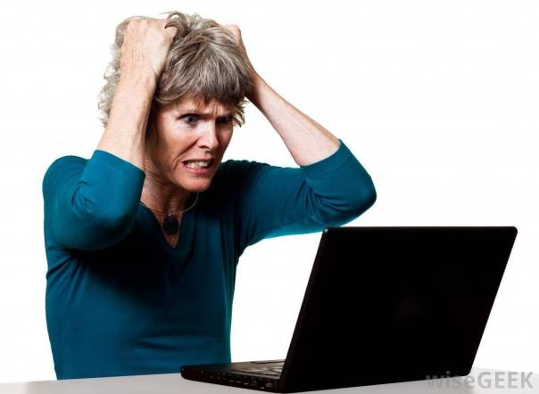 woman-with-hands-on-head-angry-at-computer-wisegeek-org