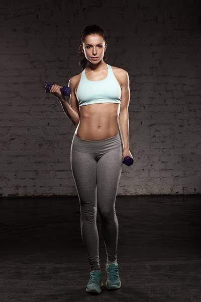 Fitness female woman with muscular body, workout with dumbbells