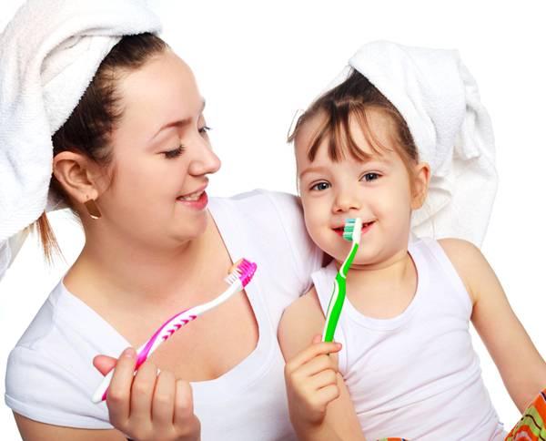 stay at home mum mulher criança dentes