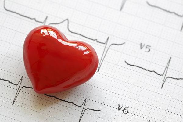 Electrocardiograph and heart shape object