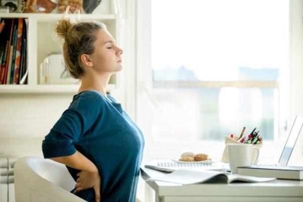 iStock- dor nas costas mulher