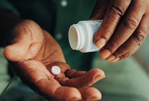 493ss_getty_rf_man_taking_pills