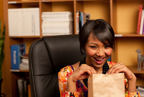 getty_rf_photo_of_woman_taking_control_by_brown_bagging_lunch