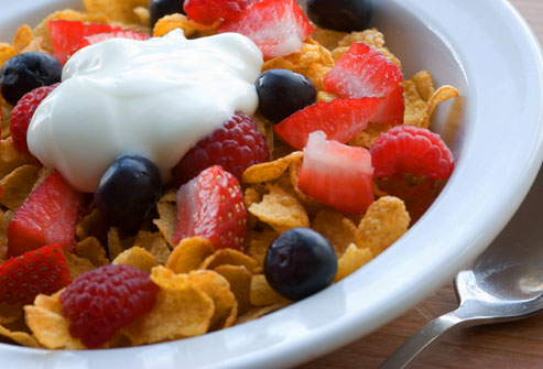 getty_rf_photo_of_yogurt_on_fruit_and_cereal