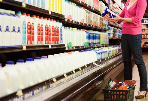 getty_rf_photo_woman_selecting_milk