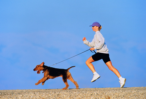 getty_rm_photo_of_woman_running_with_dog