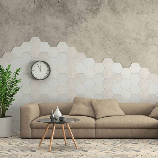 Minimalist modern interior living room with sofa and hexagon tiles on the wall