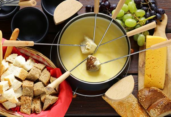cheese fondue with bread in a special dish
