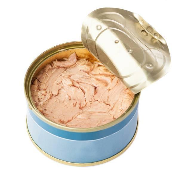 open tuna tin on a white background