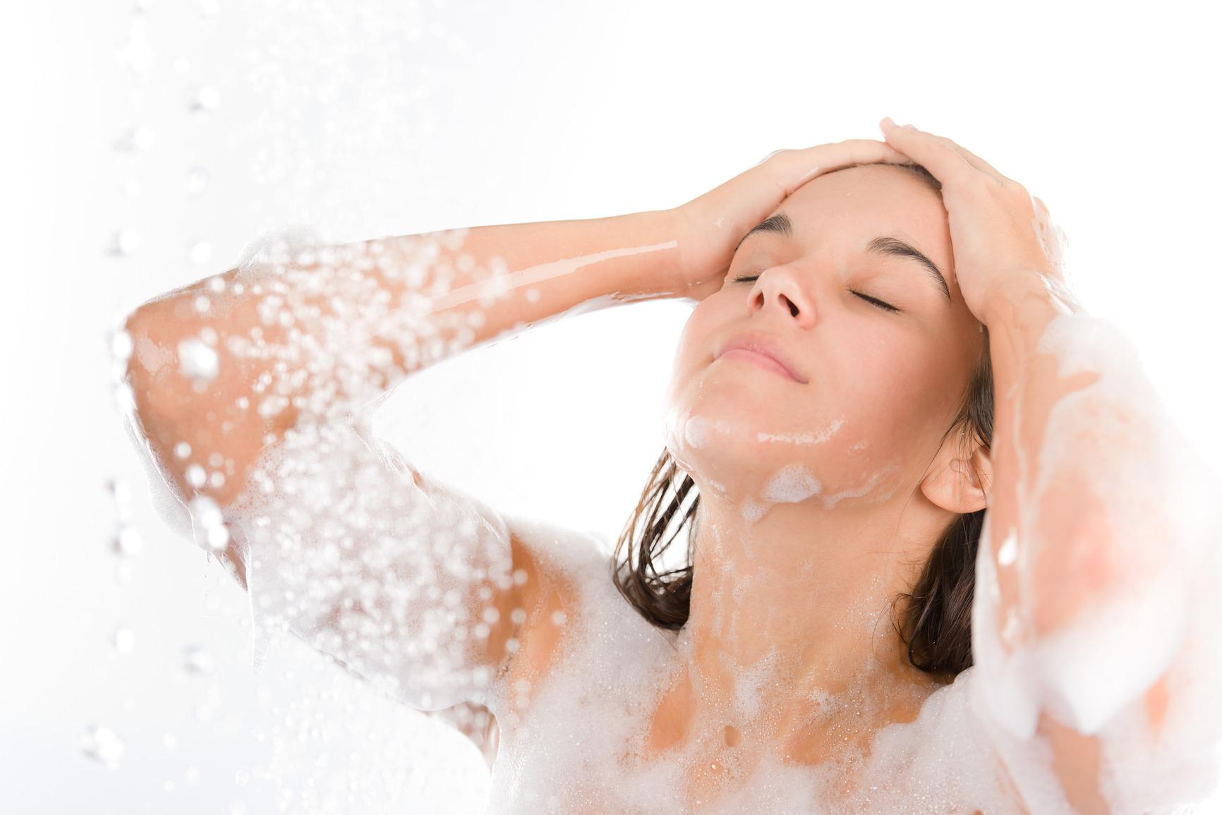 Young woman enjoy shower